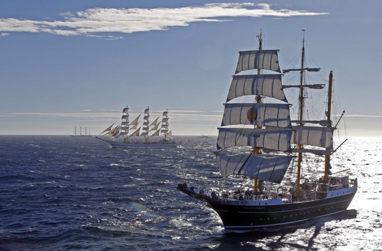 "German sailing ship ""Alexander Von Humboldt II"" (L) sails close to Russian sailing ship ""Mir"" (R) during a parade for the Mediterranean Tall Ships regatta in Toulon September 30, 2013. Some 37 tall ships have gathered for the competition which ended in a parade in the bay of Toulon. (Jean-Paul Pelissier/Reuters)"