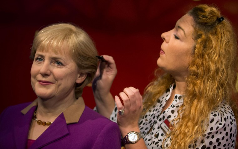 A staff member puts finishing touches to a wax figure of German Chancellor Angela Merkel before its presentation at the Madame Tussauds wax museum in Berlin. The new wax figure of Merkel, which is the second in Madame Tussauds collection, has been modeled on photographs from this year's campaign events for the upcoming general election, a spokeswoman of the museum said. (Thomas Peter /Reuters photo)