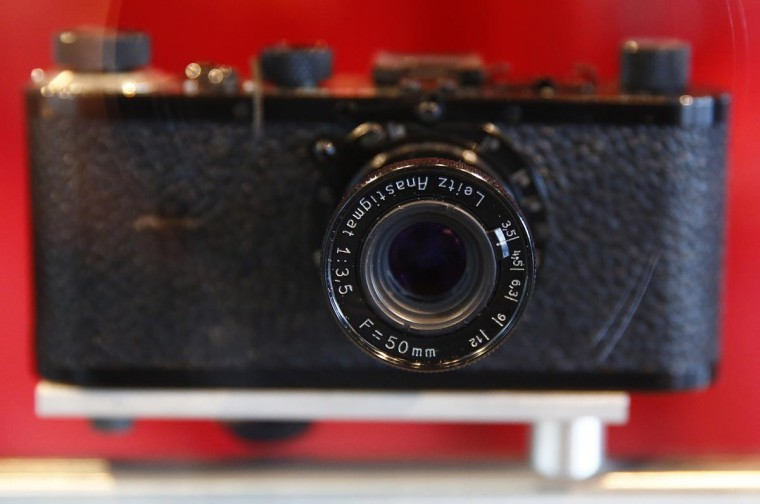 A historic Leica camera, created by Oskar Barnack is seen on display in a glass cabinet at the showroom of German camera manufacturer Leica Camera AG at their production site in Solms on September 19, 2013. Leica produces its M, S and X series at their headquarters in Solms. (Kai Pfaffenbach/Reuters)