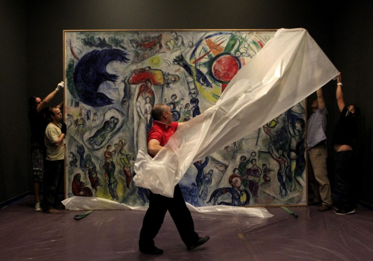 Museum workers unveil 20th century French painter Marc Chagall's painting, titled 'Life', in the Hungarian National Gallery in Budapest, September 6, 2013. The painting, one of Chagall's most important works of art, will be on display as part of an exhibition in Budapest from September 13. (Bernadett Szabo/Reuters)