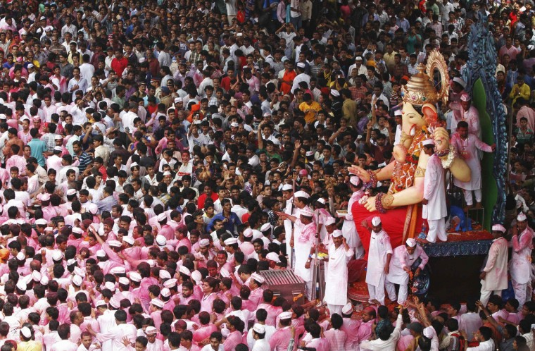 Devotees carry an idol of Hindu elephant god Ganesh, the deity of prosperity, during a procession through the streets before immersing it in the waters of the Arabian Sea on the last day of the Ganesh Chaturthi festival in Mumbai. Ganesh idols are taken through the streets in a procession accompanied by dancing and singing, and later immersed in a river or the sea symbolizing a ritual seeing-off of his journey towards his abode, taking away with him the misfortunes of all mankind. (Reuters)