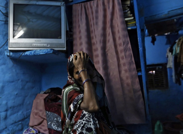 The mother of one of the four men convicted of raping and murdering a 23-year-old woman in Delhi cries upon hearing the news of the death sentence as she sits in a cot inside her house at a slum in New Delhi, September 13, 2013. All four men convicted of raping and murdering a 23-year-old woman in Delhi were sentenced to death on Friday, nine months after a crime whose savagery triggered furious protests across India and rare national debate about violence against women. (Mansi Thapliyal/Reuters)