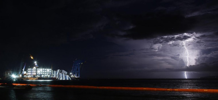 A lightning storm is pictured over the sea near the capsized cruise liner Costa Concordia, outside Giglio harbor September 15, 2013. (Tony Gentile/Reuters)