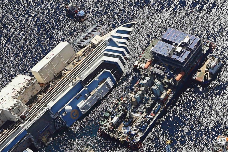 An aerial view shows the Costa Concordia as it lies on its side next to Giglio Island taken from an Italian navy helicopter August 26, 2013. (Alessandro Bianchi/Reuters)