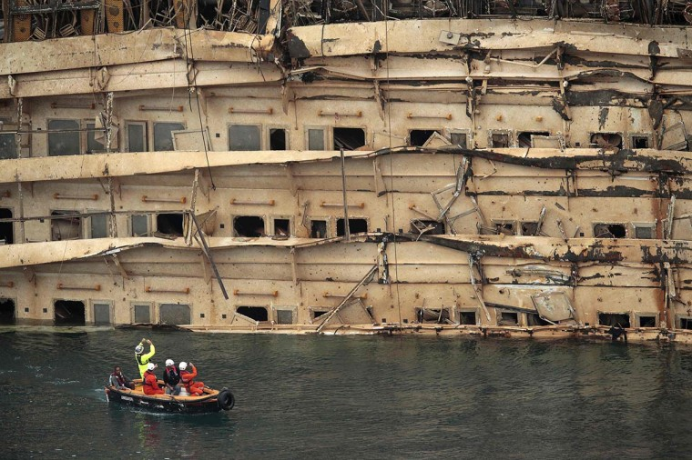 "The damaged side of the capsized cruise liner Costa Concordia is seen at the end of the ""parbuckling"" operation outside Giglio harbor September 17, 2013. (Tony Gentile/Reuters)"