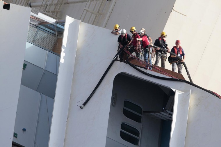 Salvage crew workers work on a side of the capsized Costa Concordia cruise liner outside Giglio harbor September 16, 2013. (Tony Gentile/Reuters)