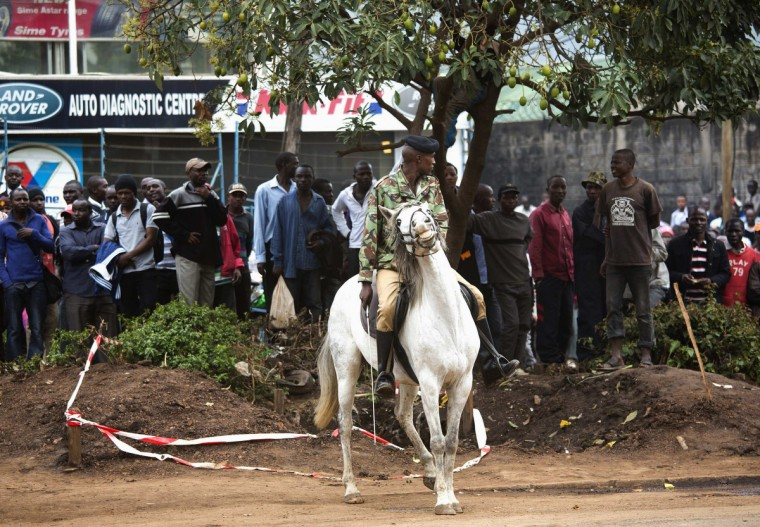 A soldier rides a horse near the Westgate shopping centre after an explosion in Nairobi, September 23, 2013. Powerful explosions sent thick smoke billowing from the Nairobi mall where militants from Somalia's al Qaeda-linked al Shabaab group threatened to kill hostages on the third day of a raid in which at least 59 have already died. (Karel Prinsloo/Reuters photo)