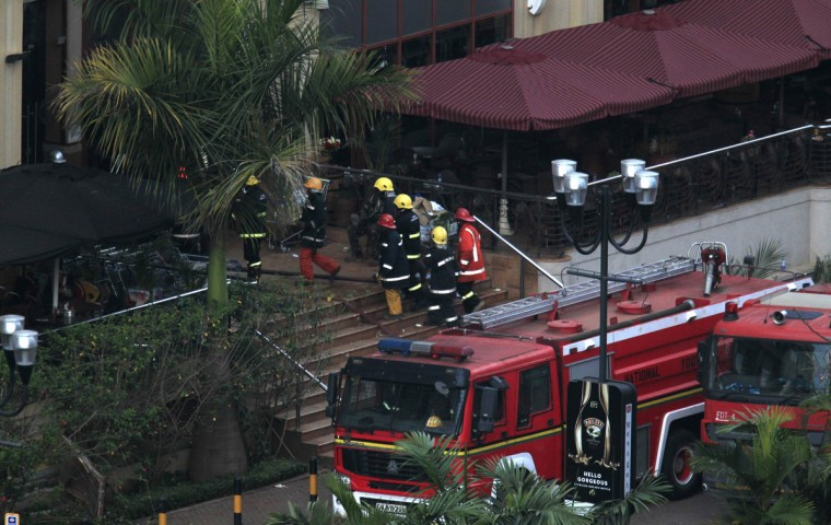 Firefighters enter Westgate shopping centre after explosions at the mall in Nairobi September 23, 2013. Thick smoke poured from the besieged Nairobi mall where Kenyan officials said their forces were closing in on Islamists holding hostages on Monday, three days after a raid by Somalia's al Shabaab killed at least 62 people. It remained unclear how many gunmen and hostages were still cornered in the Westgate shopping centre, two hours after a series of loud explosions and gunfire were followed by a plume of black smoke, that grew in volume from one part of the complex. (Noor Khamis/Reuters photo)