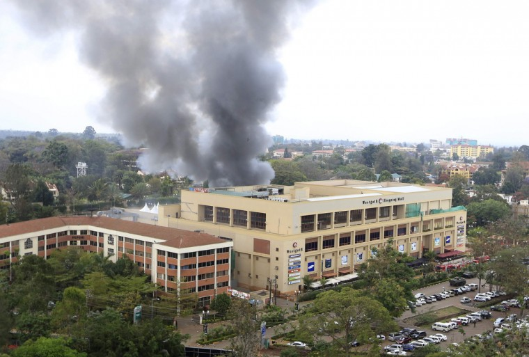 Smoke rises from the Westgate shopping centre after explosions at the mall in Nairobi September 23, 2013. Thick smoke poured from the besieged Nairobi mall where Kenyan officials said their forces were closing in on Islamists holding hostages on Monday, three days after a raid by Somalia's al Shabaab killed at least 62 people. It remained unclear how many gunmen and hostages were still cornered in the Westgate shopping centre, two hours after a series of loud explosions and gunfire were followed by a plume of black smoke, that grew in volume from one part of the complex.(Noor Khamis/Reuters photo)