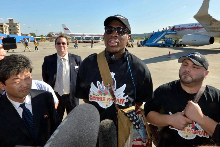 Former basketball star Dennis Rodman (C) arrives at Pyongyang airport, in this photo taken by Kyodo September 3, 2013. Flamboyant former basketball star Rodman arrived in Pyongyang on Tuesday for a five-day visit to North Korea, his second this year, but said he had no plans to negotiate the release of a jailed American missionary. Mandatory Credit. (Kyodo via Reuters)