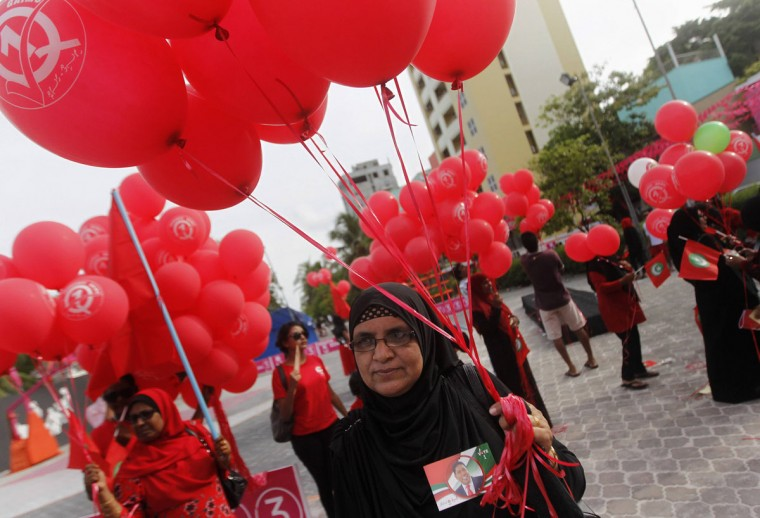 Supporters of presidential candidate Gasim Ibrahim hold balloons during a street march in Male September 6, 2013. Voters in the Maldives go to the polls on Saturday to elect a president after nearly 20 months of intermittent protests and sporadic violence triggered when the previous government was ousted. (Dinuka Liyanawatte/Reuters)