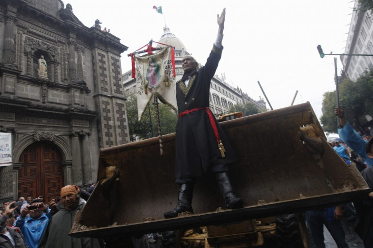 A member of the teachers' union CNTE, dressed as priest Miguel Hidalgo, the father of Mexico's independence movement from Spain, reacts as they are evicted from Zocalo Square in downtown Mexico City. (Edgard Garrido / Reuters)