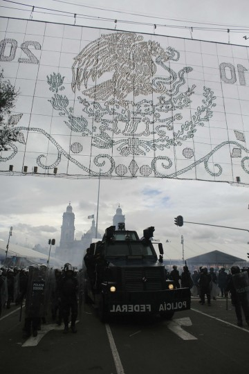 Federal riot police officers are deployed alongside a riot truck after striking members of the teachers' union CNTE were evicted from Zocalo Square in downtown Mexico City. (Tomas Bravo / Reuters)