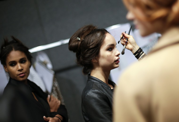 A model has her make-up applied backstage for the Blugirl Spring/Summer 2014 collection during Milan Fashion Week. (Max Rossi/Reuters photo)