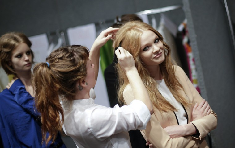 A model has her hair styled backstage for the presentation of the Blugirl Spring/Summer 2014 collection during Milan Fashion Week . (Max Rossi/Reuters photo)