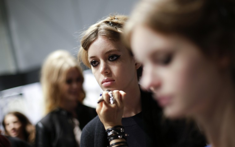 A model has her make-up applied backstage for the presentation of the Blugirl Spring/Summer 2014 collection during Milan Fashion Week. (Max Rossi/Reuters photo)