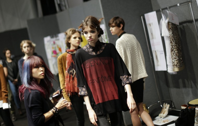 Models prepare backstage for the Blugirl Spring/Summer 2014 collection during Milan Fashion Week. (Max Rossi/Reuters photo)
