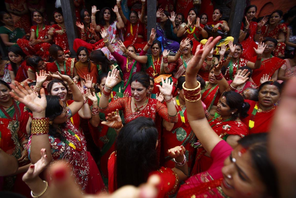 Nepalese women dancing in Pashupatinath temple premise, in Kathmandu