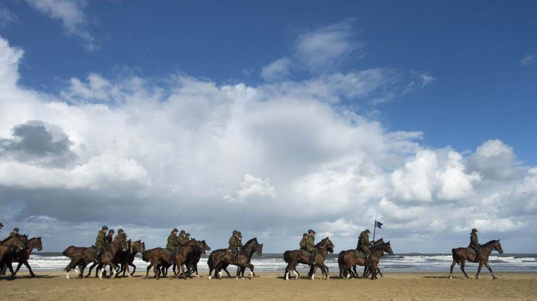 Members of the Dutch Royal Guard of Honour guide their horses during a rehearsal ahead of the Dutch 2014 budget presentation, at the beach of Scheveningen September 16, 2013. (Toussaint Kluiters/Reuters)
