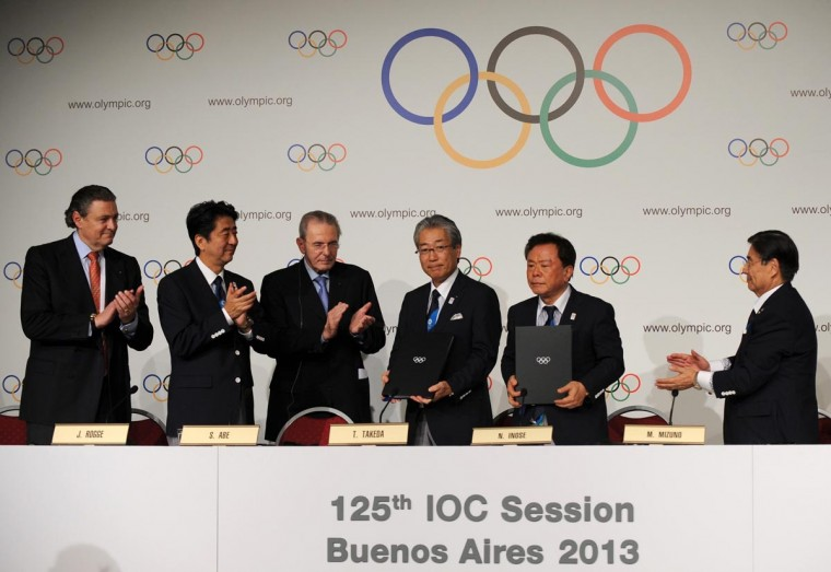 Prime Minister Shinzo Abe of Japan (2nd L) stands with Jacques Rogge (3rd L) president of the International Olympic Committee (IOC), Governor of Tokyo Naoki Inose (2nd R) and Japan's Olympic Committee President Tsunekazu Takeda (3rd R) during the Signature of the Host City Contract ceremony after Tokyo was selected as the city to host the 2020 Summer Olympic Game in Buenos Aires September 7, 2013. (Charli Diaz Azcue/Reuters)