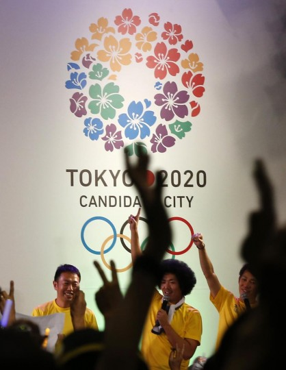 People celebrate after hearing that Tokyo had been chosen to host the 2020 Olympic Games during a public viewing event in Tokyo September 8, 2013. Tokyo was awarded the 2020 summer Olympic Games on Saturday following a vote by the International Olympic Committee. (Toru Hanai/Reuters)