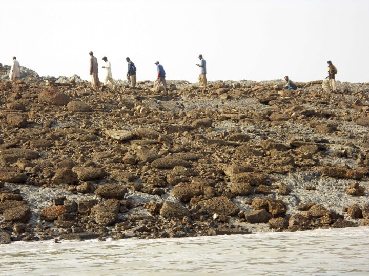 People walk on an island that rose from the sea following an earthquake, off Pakistan's Gwadar coastline in the Arabian Sea. A major earthquake hit a remote part of western Pakistan on Tuesday, killing at least 45 people and prompting the new island to rise from the sea just off the country's southern coast. The earthquake was so powerful that it caused the seabed to rise and create a small, mountain-like island about 600 meters off Pakistan's Gwadar coastline. Television channels showed images of a stretch of rocky terrain rising above the sea level, with a crowd of bewildered people gathering on the shore to witness the rare phenomenon. (Reuters)