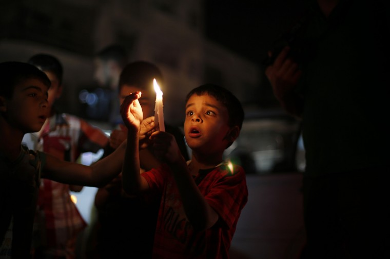 Palestinian children light candles during a protest against power cuts and the blockade on the Gaza Strip, in Gaza. Israel imposed a blockade on Gaza in 2007 after its enemy, Islamist group Hamas, seized control of the territory in a brief civil war with Western-backed Palestinian President Mahmoud Abbas's Fatah party. (Suhaib Salem/Reuters photo)