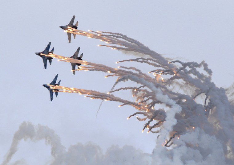 "Sukhoi Su-27 jet fighters release flares as they perform during the ""Russia Arms Expo 2013"" 9th international exhibition of arms, military equipment and ammunition, in the Urals city of Nizhny Tagil. (Sergei Karpukhin/Reuters)"