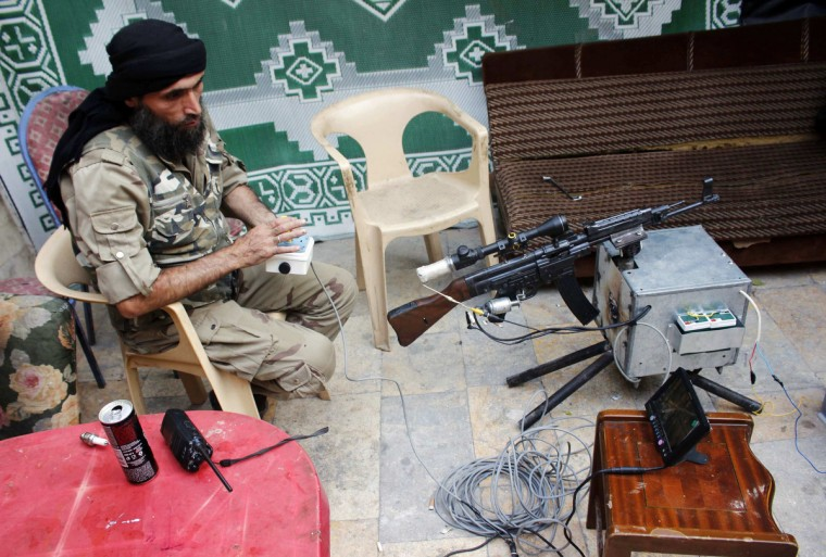 A Free Syrian Army fighter tests a remote-controlled weapon in the old city of Aleppo. (Molhem Barakat/Reuters)