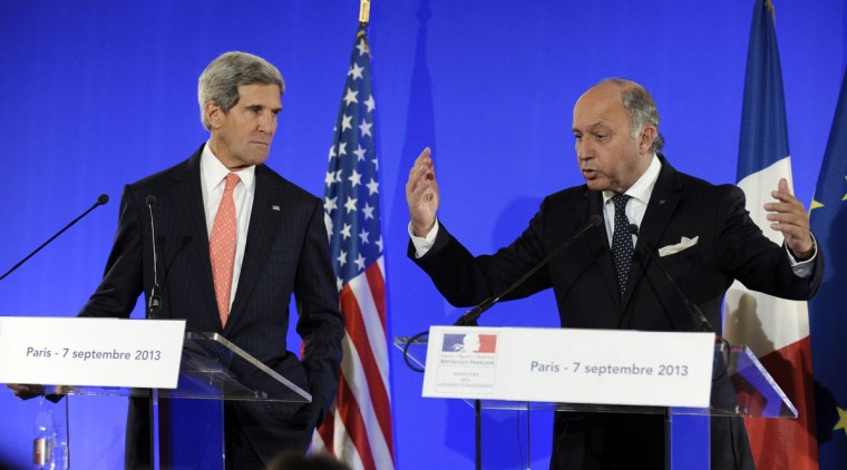 U.S. Secretary of State John Kerry and France's Foreign Minister Laurent Fabius (right) hold a news conference at the Ministry of Foreign Affairs in Paris September 7, 2013. U.S. President Barack Obama has made no decisions about waiting for a U.N. weapons inspectors' report on chemical arms use in Syria and he is keeping all his options open, Kerry said on Saturday. (Susan Walsh/Pool/Reuters)
