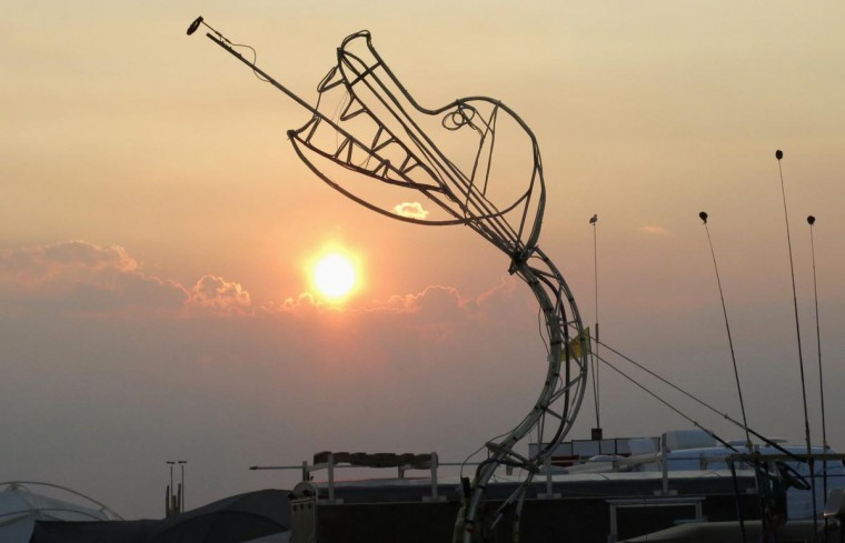 A sculpture of a fire breathing dragon is seen at sunrise during the 2013 Burning Man arts and music festival in the Black Rock Desert of Nevada, August 29, 2013. (Jim Bourg/Reuters)