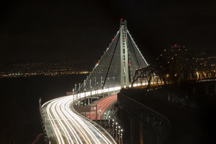 Vehicles drive on the new eastern span of the San Francisco-Oakland Bay bridge in San Francisco, California September 2, 2013. The largest self-anchored suspension bridge in the world opened six years behind schedule and five times over budget. Picture taken with a long exposure. (Stephen Lam/Reuters)