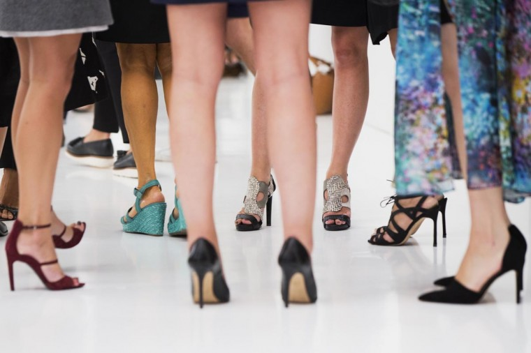 Women in high heels stand on the runway before a presentation of the Victoria Beckham Spring/Summer 2014 collection during New York Fashion Week, September 8, 2013. (Lucas Jackson/Reuters)