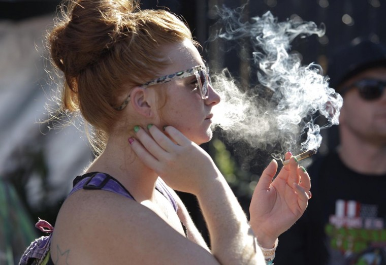 A woman smokes a joint at the High Times U.S. Cannabis Cup in Seattle, Washington September 8, 2013. (Jason Redmond/Reuters)