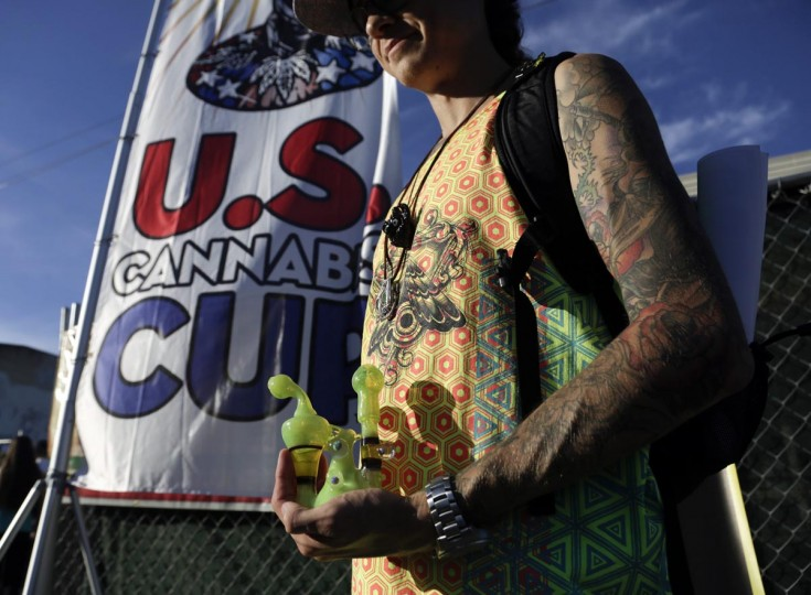 An attendee holds a water pipe at the High Times U.S. Cannabis Cup in Seattle, Washington September 8, 2013. (Jason Redmond/Reuters)