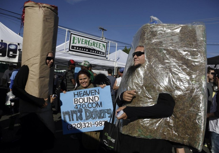 Members of a medical marijuana delivery service promote their business at the High Times U.S. Cannabis Cup in Seattle, Washington September 8, 2013. (Jason Redmond/Reuters)