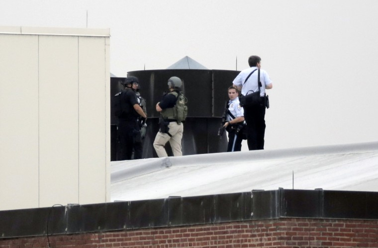 Law enforcement officers are deployed on a rooftop as they respond to a shooting on the base at the Navy Yard in Washington, September 16, 2013. The U.S. Navy said several people were injured and there were possible fatalities in the shooting at the Navy Yard in Washington D.C. on Monday. The Navy did not immediately provide additional details but a Washington police spokesman said earlier that five people had been shot, including a District of Columbia police officer and one other law enforcement officer. (Jason Reed/Reuters)