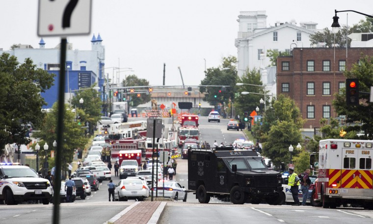 Police block off the M Street, SE, as they respond to a shooting at the Washington Navy Yard in Washington, September 16, 2013. The U.S. Navy said several people were injured and there were possible fatalities in the shooting at the Navy Yard in Washington D.C. on Monday. The Navy did not immediately provide additional details but a Washington police spokesman said earlier that five people had been shot, including a District of Columbia police officer and one other law enforcement officer. (Joshua Roberts/Reuters)