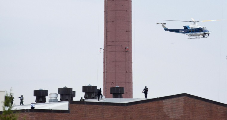 Police walk on the roof of a building as they respond to a shooting at the Washington Navy Yard in Washington, September 16, 2013. The U.S. Navy said several people were injured and there were possible fatalities in the shooting at the Navy Yard in Washington D.C. on Monday. The Navy did not immediately provide additional details but a Washington police spokesman said earlier that five people had been shot, including a District of Columbia police officer and one other law enforcement officer. (Joshua Roberts/Reuters)
