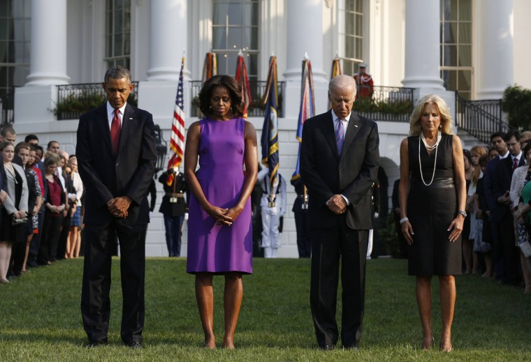 U.S. President Barack Obama, first lady Michelle Obama, Vice President Joseph Biden and his wife Jill Biden observe a moment of silence on the South Lawn of the White House in Washington September 11, 2013, on the 12th anniversary of the September 11 attacks on the World Trade Centre and the Pentagon. (Larry Downing/Reuters)