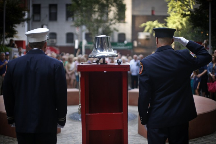 New York City firefighters from Engine 54, Ladder 4, Battalion 9, stand during a moment of silence at a ceremony in a park dedicated to honoring members of the firehouse on West 48th Street who lost their lives in the September 11, 2001 attacks on the World Trade Center on the 12th anniversary of the attacks in New York, September 11, 2013. 15 fire fighters from Engine 54, Ladder 4, Battalion 9 died in the 9/11 attacks, the most of any fire company in New York. (Mike Segar/Reuters)