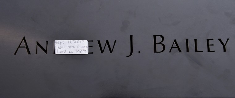 A note is left on the name of a victim etched in the wall at the North Pool of the 9/11 Memorial during a ceremony marking the 12th anniversary of the 9/11 attacks on the World Trade Center in New York September 11, 2013. (Justin Lane/Reuters)