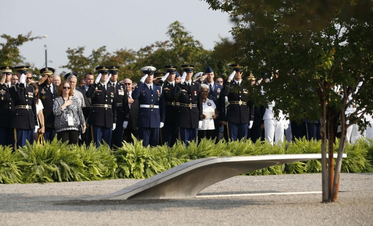 Participants stand at attention during an event on the 12th anniversary of the 9/11 attacks, at the Pentagon memorial near Washington September 11, 2013. Bagpipes, bells and a reading of the names of the nearly 3,000 people killed when hijacked jetliners crashed into the World Trade Center, the Pentagon and a Pennsylvania field marked the 12th anniversary of the September 11 attacks in 2001. (Jason Reed/Reuters)