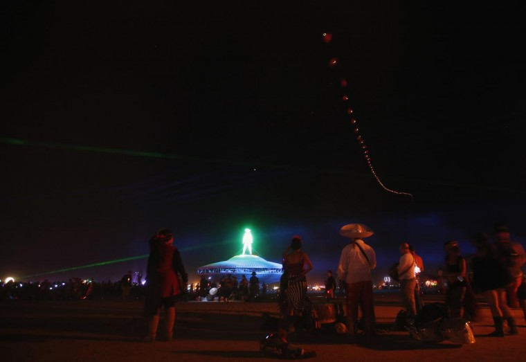 People wait before the Man burns during the Burning Man 2013 arts and music festival in the Black Rock Desert of Nevada, August 31, 2013. (Jim Urquhart/Reuters)