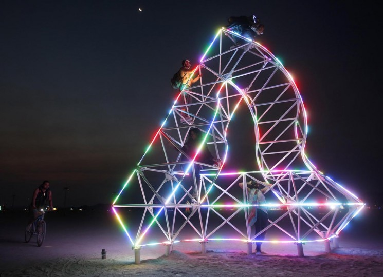Participants climb an art installation before sunrise at the Burning Man 2013 arts and music festival in the Black Rock Desert of Nevada, August 31, 2013. (Jim Urquhart/Reuters)