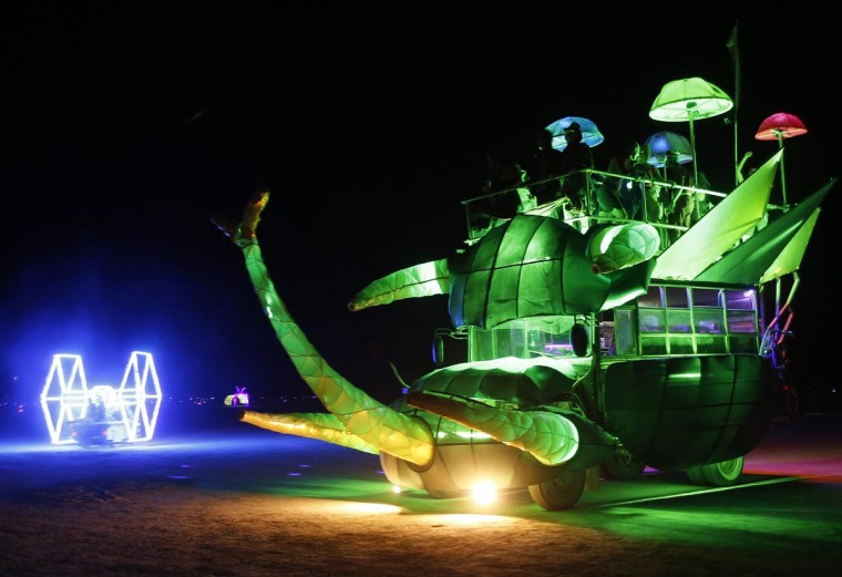 Mutant vehicles drive across the Playa during the Burning Man 2013 arts and music festival in the Black Rock Desert of Nevada, August 31, 2013. (Jim Urquhart/Reuters)
