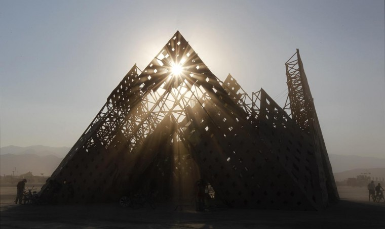 "The sun sets over the ""Cradle of Mir"" art installation at the 2013 Burning Man arts and music festival in the Black Rock desert of Nevada, August 30, 2013. (Jim Bourg/Reuters)"