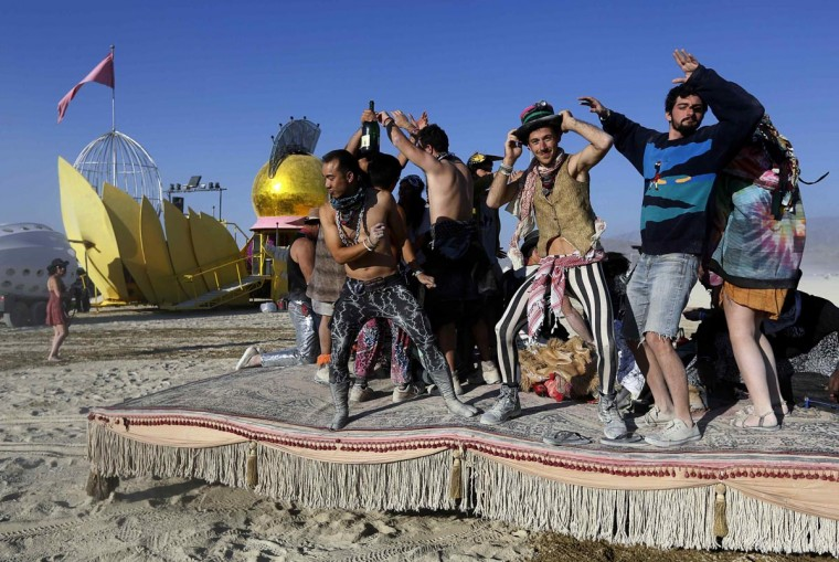 "Participants dance atop a moving ""hookah lounge"" art car at the 2013 Burning Man arts and music festival in the Black Rock desert of Nevada, August 30, 2013. (Jim Bourg/Reuters)"