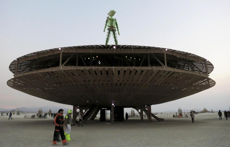 Participants walk past the effigy of the Man, seen at the center of the 2013 Burning Man arts and music festival in the Black Rock Desert of Nevada, August 29, 2013. (Jim Bourg/Reuters)
