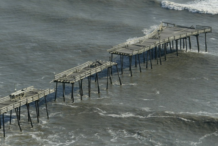 A pier damaged by Hurricane Isabel is shown in Kitty Hawk, North Carolina, September 19, 2003. The storm has left 13 dead and 4.5 million homes and businesses without power from the Carolinas to New York. (Joe Skipper/Reuters photo)